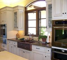 copper kitchen appliances traditional with white cabinets apron