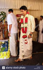hindu wedding dress for and groom taking of mandapam during an indian hindu