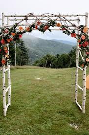 wedding arch log pom poms