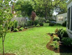 Landscape Design Backyard by Landscaping Along Privacy Fence Wood Fence Residential
