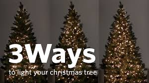 how to put lights on a christmas tree video how to hang christmas tree lights 3 different ways youtube