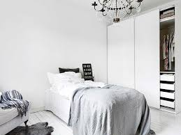 warm white bedroom with chandelier soft furniture u0026 blankets