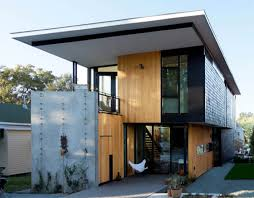 two compact modern homes fill challenging empty lots in an old