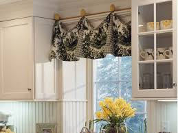 kitchen floral green curtains with rings hanging on wrought iron