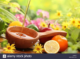 flowers and fruits honey and fresh fruits with flowers background closeup stock photo