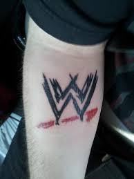 cool wwe logo tattoo on forearm