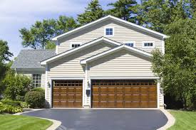 Residential Overhead Doors by Storm Damage Repair All Craft Exteriors 507 424 3323 Roofing