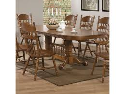 coaster brooks oak finish oval dining table with trestle base