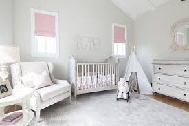 pink and gray nursery with initials over crib transitional nursery