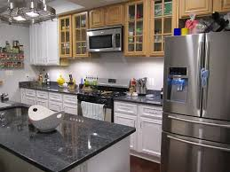 granite countertop white kitchen cabinets with crown molding