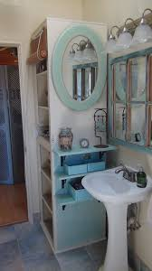 rustic bathroom interior with white standing sink and oval blue