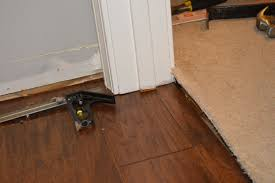 Laminate Flooring At Doorways What We Learned About Laying Hardwood Flooring Part 2 Loving Here