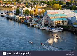 boats and floating houses in false creek along granville island