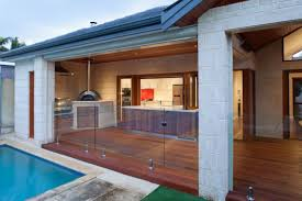 great wood laminated floor design and modern outdoor kitchen