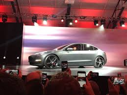 tesla u0027s model 3 is here u2014with a 215 mile range to be delivered in