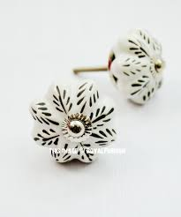 kitchen cabinet knobs black and white white black leaves painted ceramic cabinet knob set of two