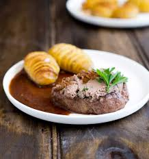 tournedos rossini steak mignon with pate sprinkles and sprouts