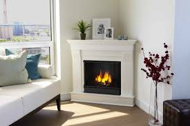 decor corner gas fireplace with wooden floor and white wall for