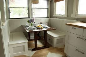 dining room white stained wood corner nook table with storage