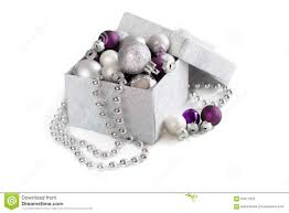 silver and purple ornaments in gift box stock photo