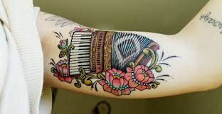 tattoos com 12 charming accordion tattoos for all you music lovers