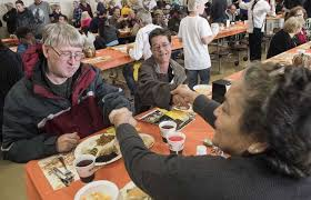 thanksgiving feasts in cater to refugees the homeless