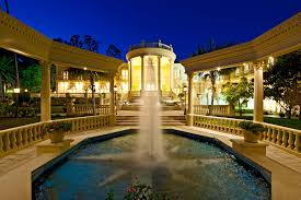 gorgeous night view of extravagant houses that showing cool exterior gorgeous night view of extravagant houses that showing cool fountain in the middle part