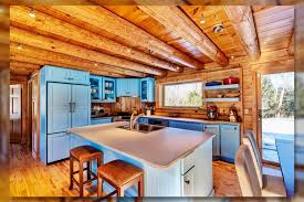 blue kitchen cabinets in cabin 30 impressive cabin kitchen ideas 2021 you should see