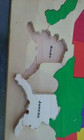 wooden usa map puzzle with states and capitals large wooden map puzzle of the united states tells you all of the