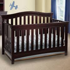 Dark Wood Cribs Convertible by Featuring Sturdy Wood Construction The Delta Bennington Curved 4