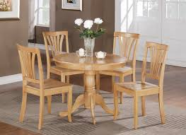 furniture wooden round kitchen table with flower decoration added