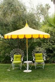poolside umbrellas pretty porches and patios pinterest palm