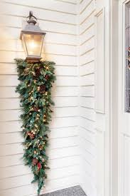 Christmas Decorations For Porch Lights by Altogether Christmas Decorating Outdoor Christmas Decorating