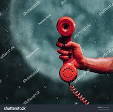 halloween background devil red devil hand gives phone handset stock photo 218991679
