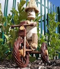 wooden log on wicker bike garden ornament
