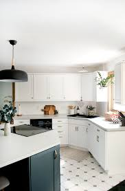 can laminate kitchen cupboards be painted how to add trim and paint your laminate cabinets brepurposed