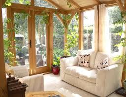 sunroom with upholstered sofa and climbing houseplants choosing