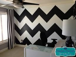 a simple way to paint a chevron print wall using cheap ribbon and