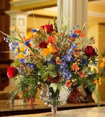 state how to use silk flowers so y look fool real silk