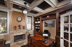 home office with fireplace and coffered ceiling interior rooms
