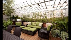 stylish rooftop garden ideas with flowering plants and green