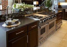range in island kitchen with the slide in stove in the island can t say that