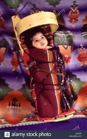 native american baby laced up onto a traditional navajo wooden