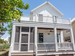 3 bedroom 2 bath two story cottage with wrap around porches on