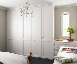 Luxury Fitted Bedroom Furniture Tall Wardrobes Along Left Wall Dressing Table Drawers With Mirror