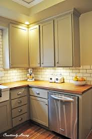 white beadboard cabinets butcher block counter yellow walls