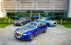 rolls royce wraith blue rolls royce phantom coupé left ghost right and wraith front