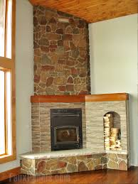 cozy corner fireplace ideas creative faux panels designing a corner fireplace with stone veneer adds a cozy mountain feel