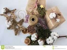 christmas gift boxes with flowers and decorative objects eco