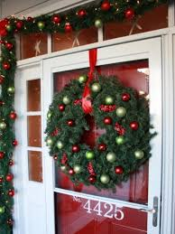 christmas porch decorations lighted garland and red bows create a